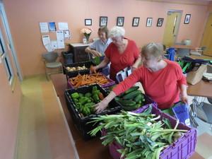 Margaret LaPalme, Shirley Bak, and Susan Holden sort produce from Crimson & Clover Farm. Photo: John Body