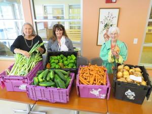 Pat Shaughnessy (Director, Senior Center), Michele Dihlmann (Senior Center Social Worker), Carol Boyer (Grow Food Northampton volunteer) set up for food distribution. Photo: John Body
