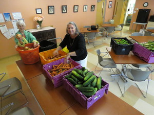 Unloading produce at the Center are Carol Boyer (Grow Food Northampton volunteer) and Pat Shaughnessy (Director, Senior Center). Photo: John Body.