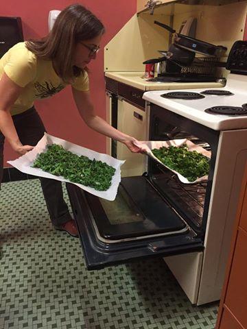 MassLIFT-AmeriCorps member Katie makes kale chips for the Red Bag Program