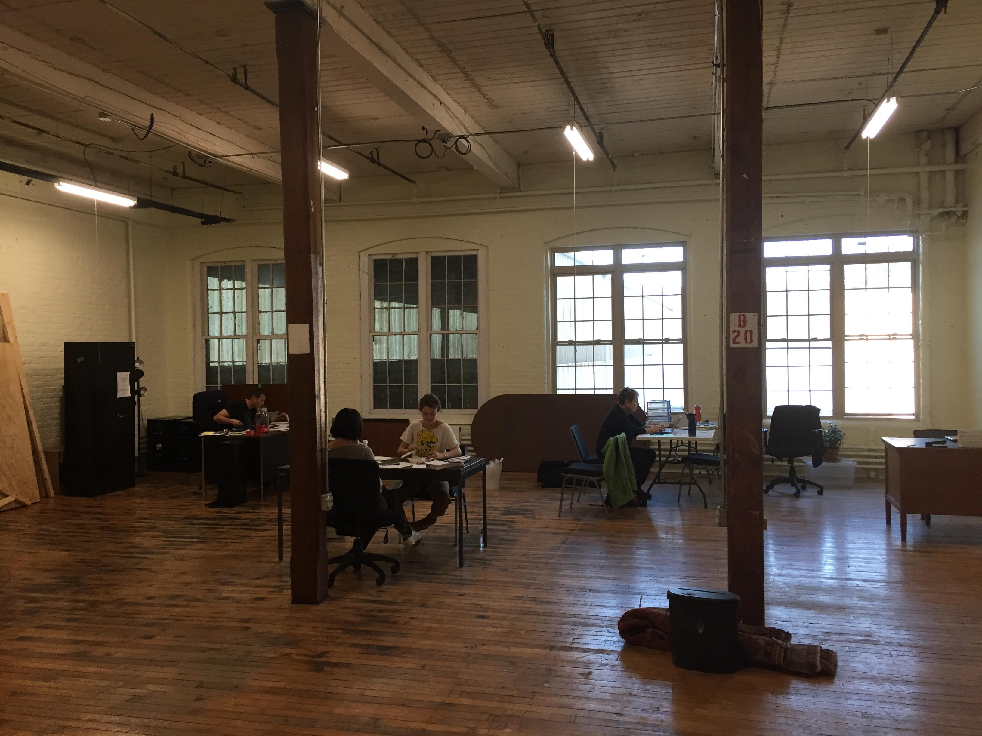 Staff members hard at work in our new space in Florence