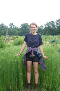 Bridget MacNeil in front of broom corn