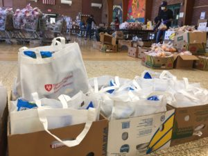 Food is organized for distribution at Jackson Street School in Northampton